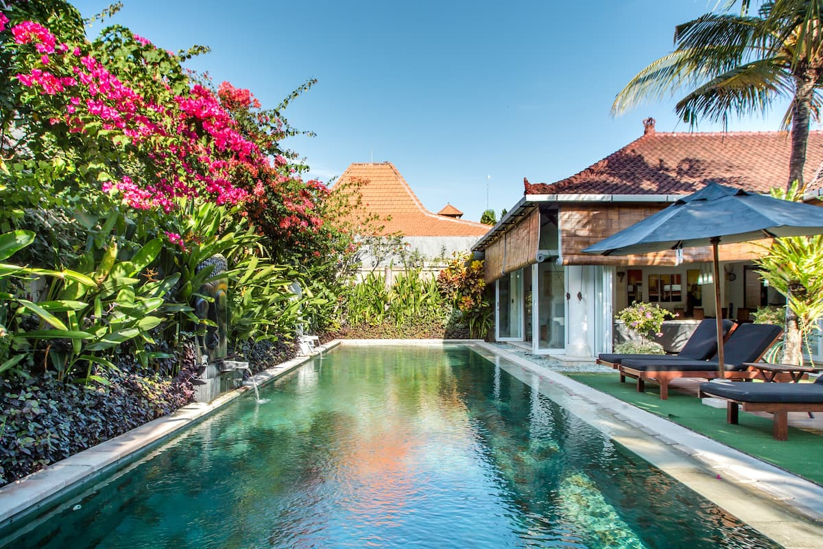 Explore Sanur from a Villa with a Garden-wrapped Pool