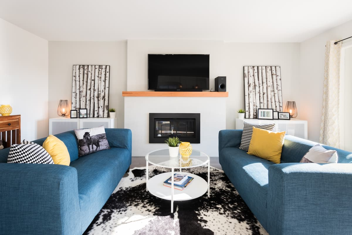 Kick Back by Cozy Fireplace in Colourful North Van Home