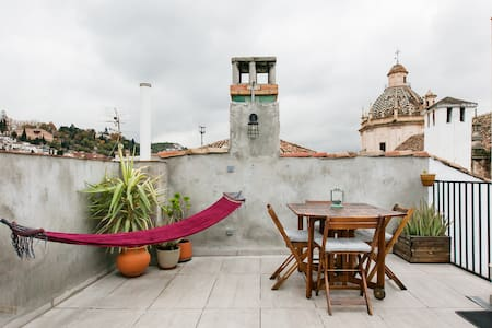 Explore History and Tapas Bars from an Apartment with a View