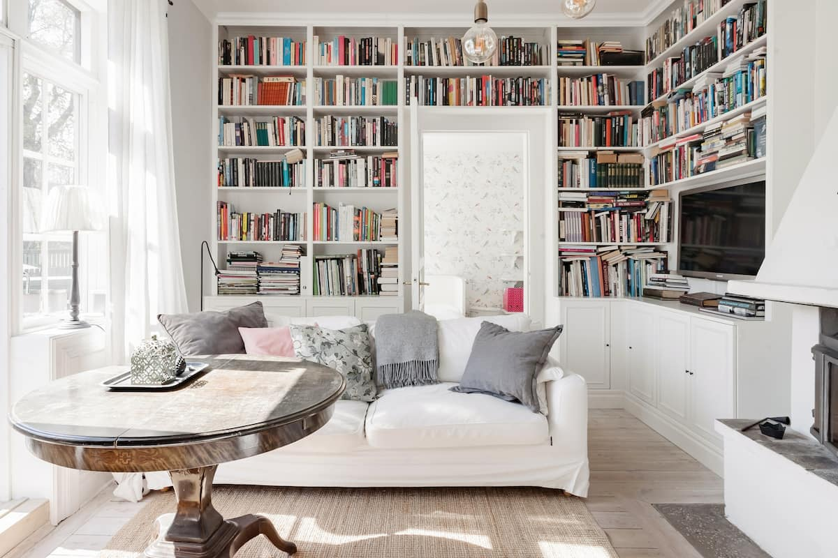 Savor Sea Views at a Sweet Retreat with Heaving Bookshelves