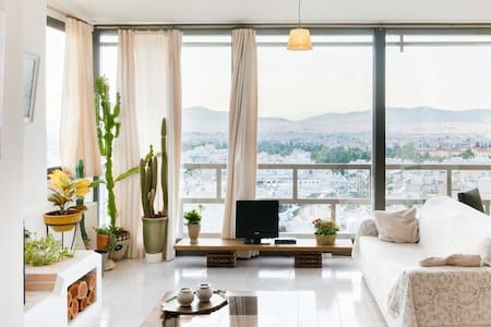 Sunny penthouse with great views of Lycabettus hill Acropolis and all of Athens