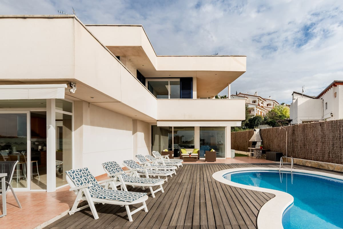 Relax Poolside at this Incredible Mediterranean Villa