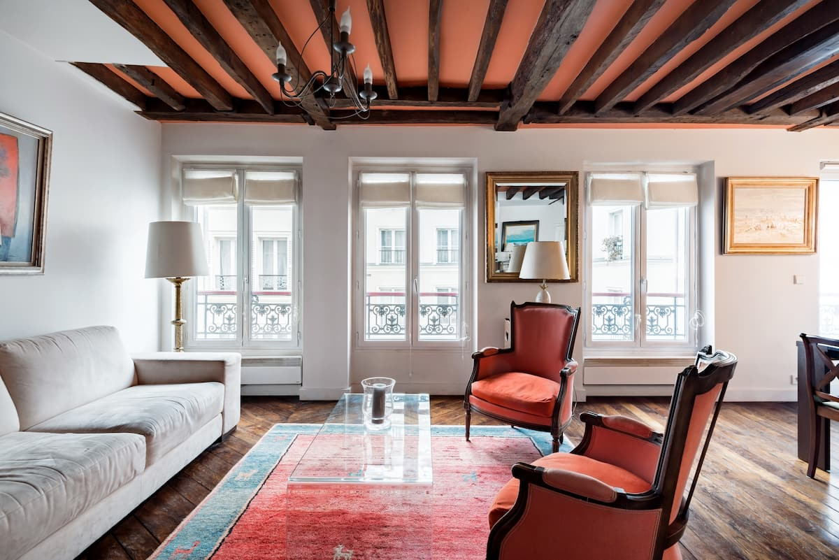Lounge in an Elegant Armchair Under the Historic Beams