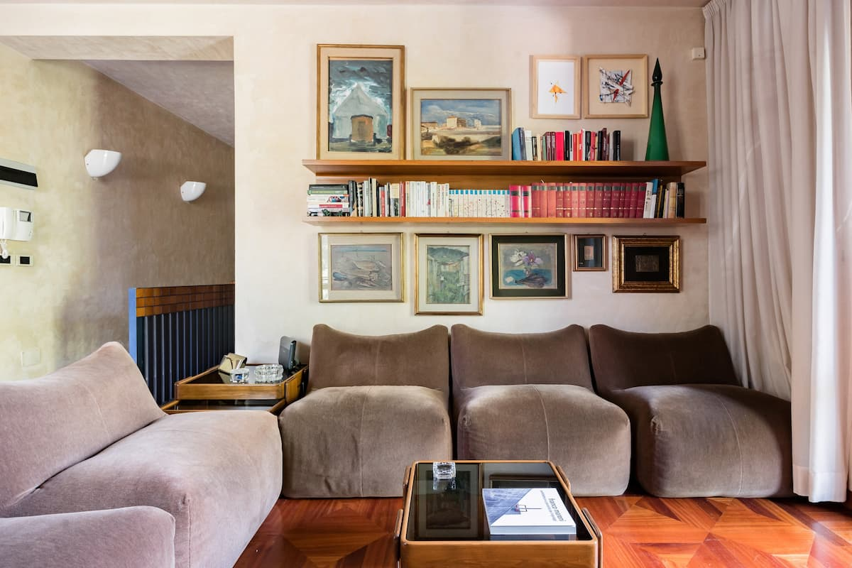 Serene Apartment Filled With Books and Art in Historic Terni