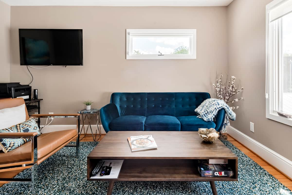 Lounge on the Sapphire Velvet Couch at a Fresh Mill House