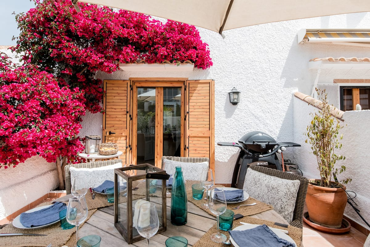 Dine Alfresco Under Vivid Bougainvillea at a Sea View Escape