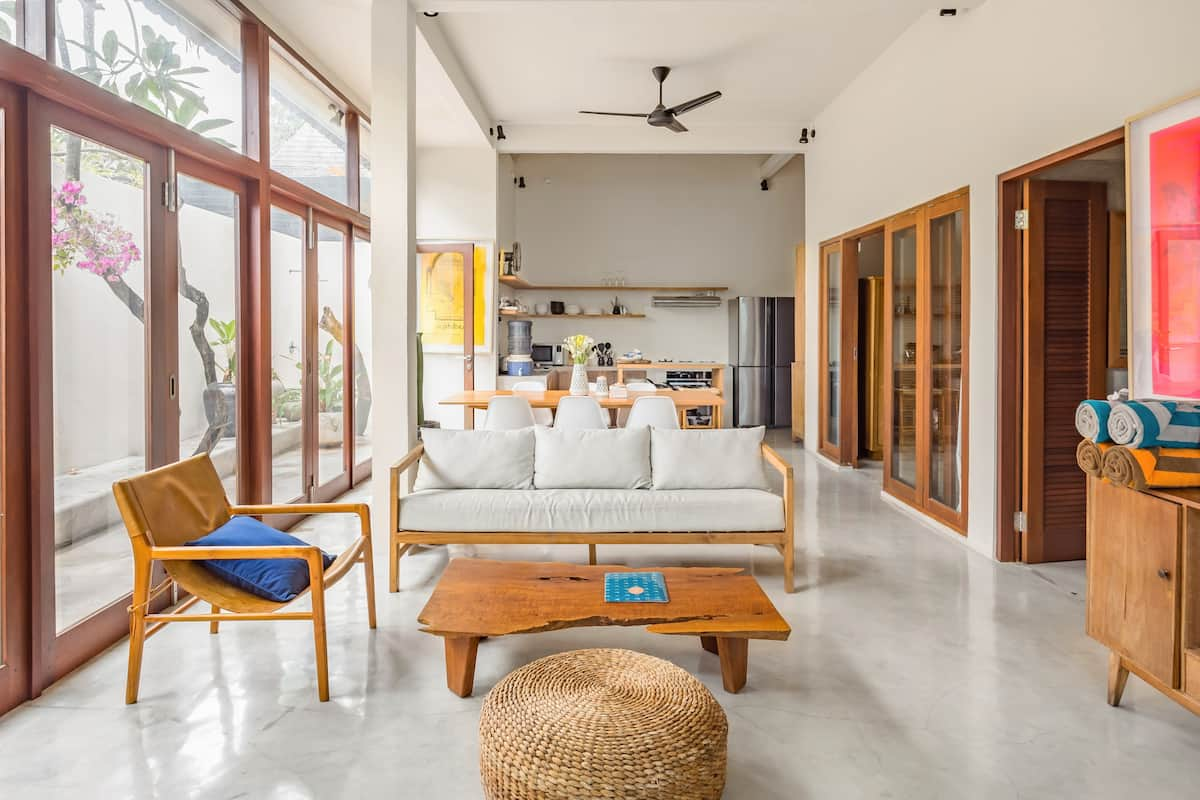 Walk to the Beach From a Stylish Villa with a Pool