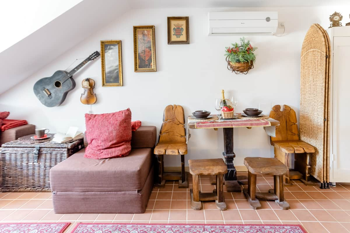 Step Out to the Main Square From a Romantic Loft Apartment