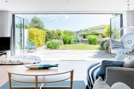 Explore Dartmouth From a Contemporary, Light-Filled Home