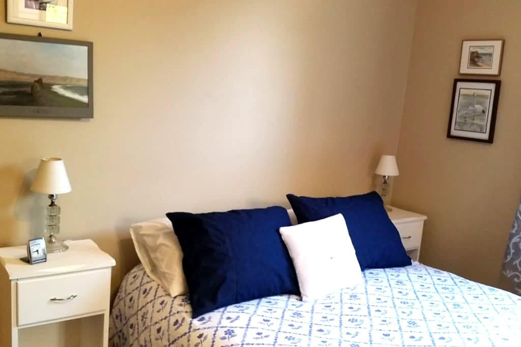 Comfy bed in French Provincial style room - Toronto