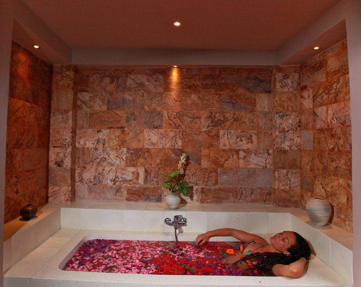 Spoil yourself in our large indoor outdoor bathroom surrounded by beautiful natural stone.