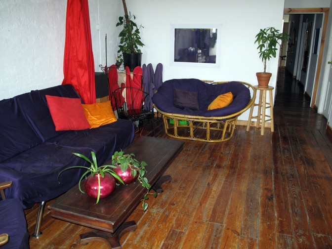 Living room. Tiny guestroom behind love seat.