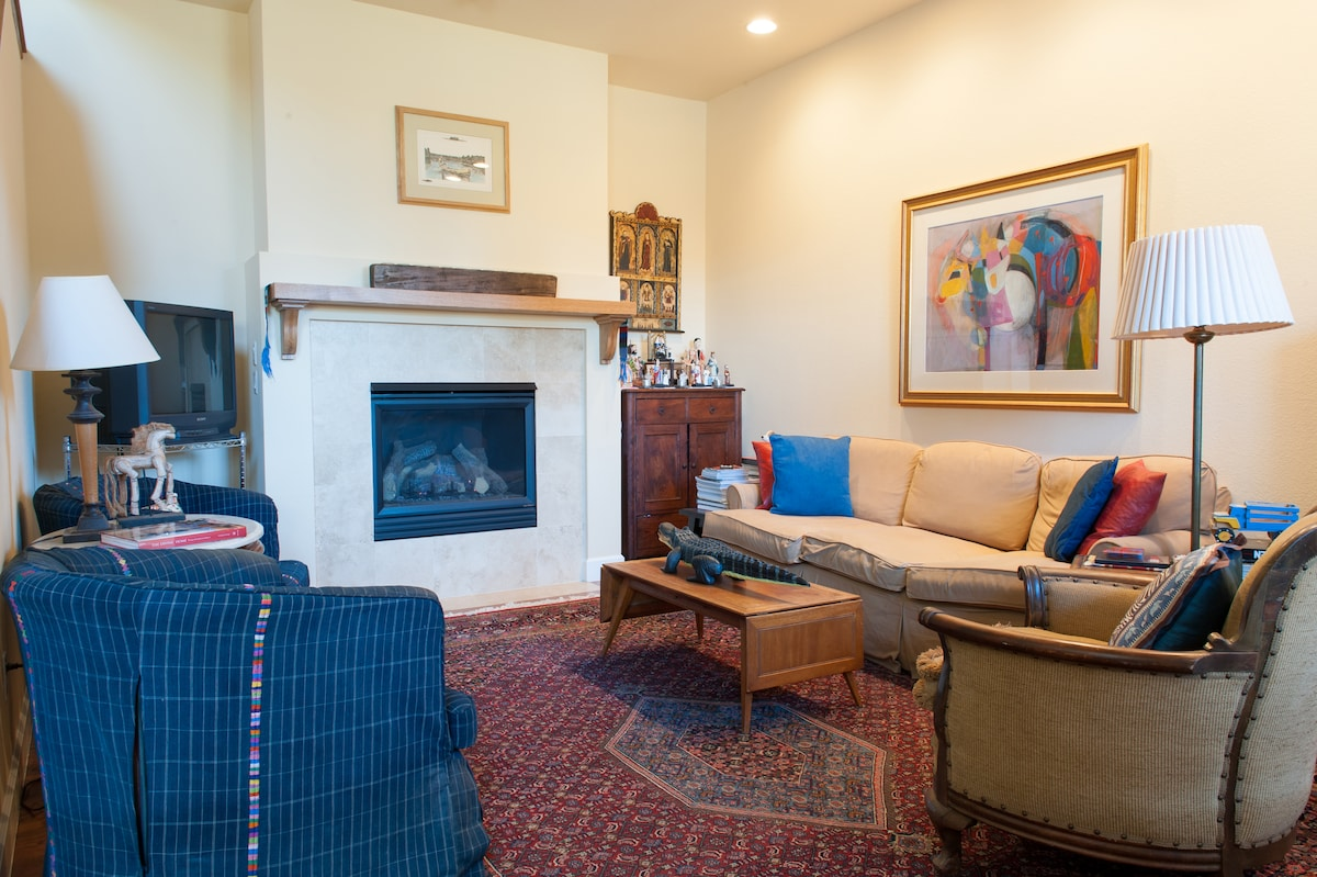 The living room features a gas fireplace.