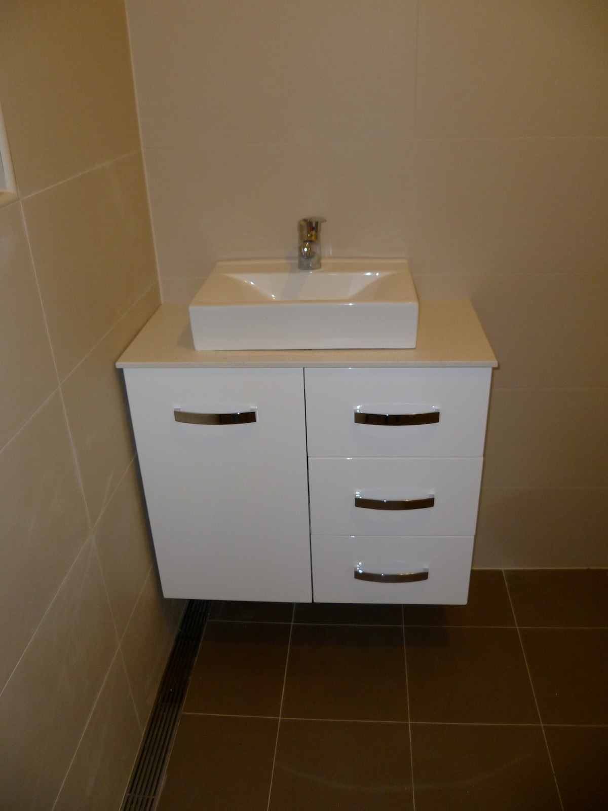 Heated flooring fully tiled wet-room including toilet vanity, shower facility. Note: No bath.