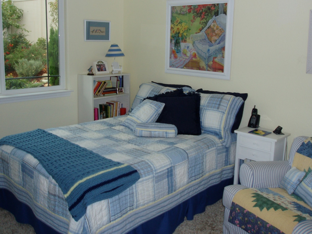 This cozy bedroom comes with a double bed, overstuffed chair, dresser, closet space, & access to the guest bathroom with tub/shower.