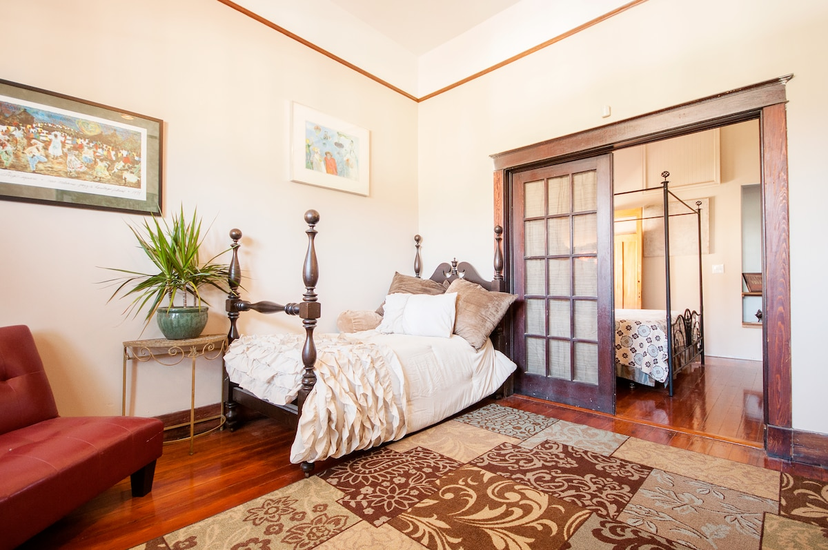 Extra twin bed in parlor with full futon and large french doors for even more privacy and space.