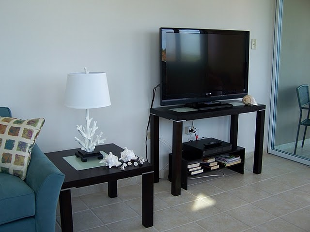"42"" flatscreen LCD w Direct TV in living room."