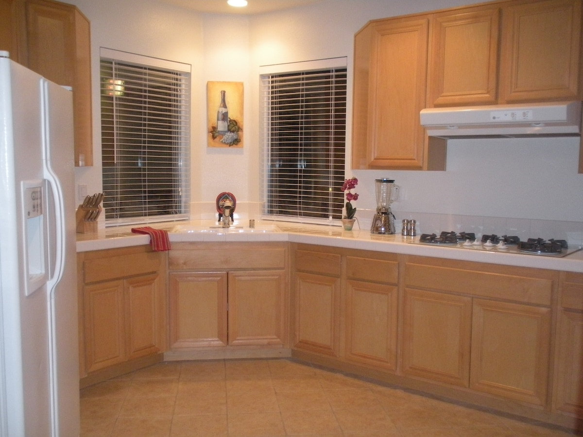 Bright & spacious kitchen with microwave, blender, toaster & coffee maker.