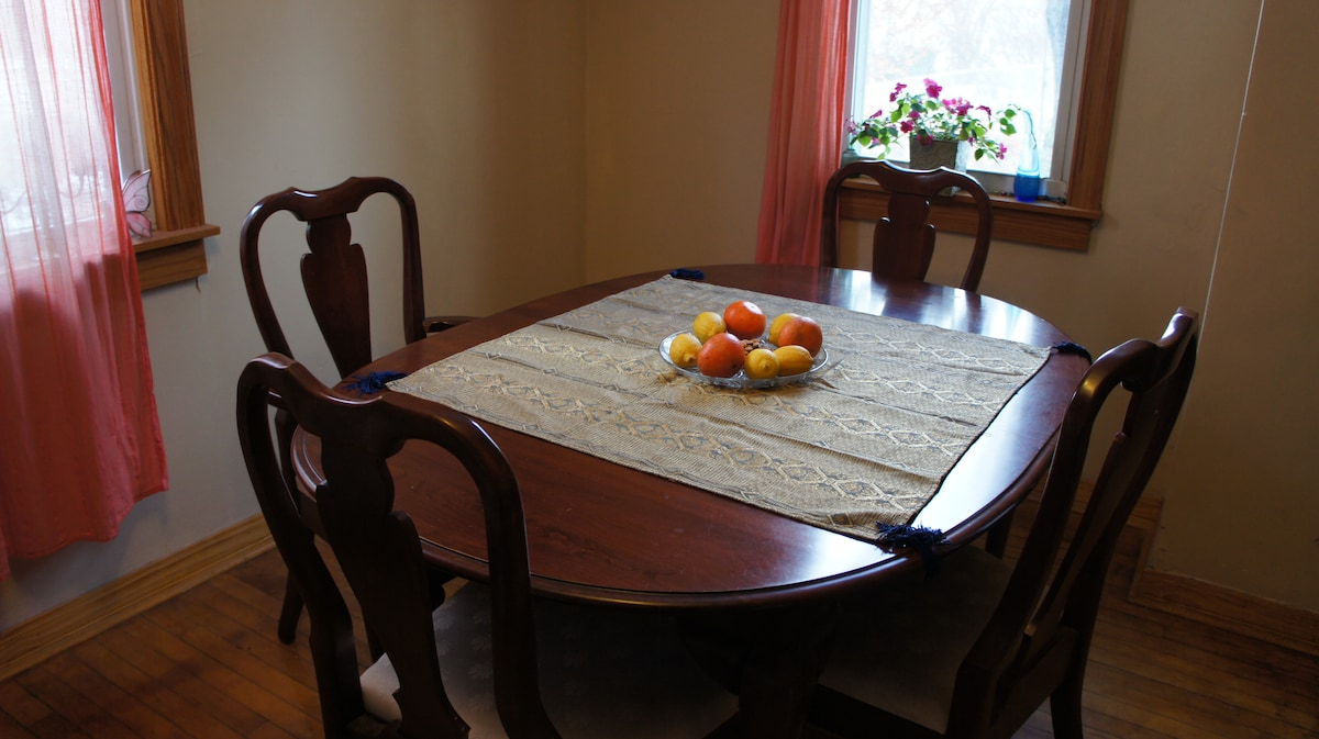 Big kitchen table can be extended to fit more people.