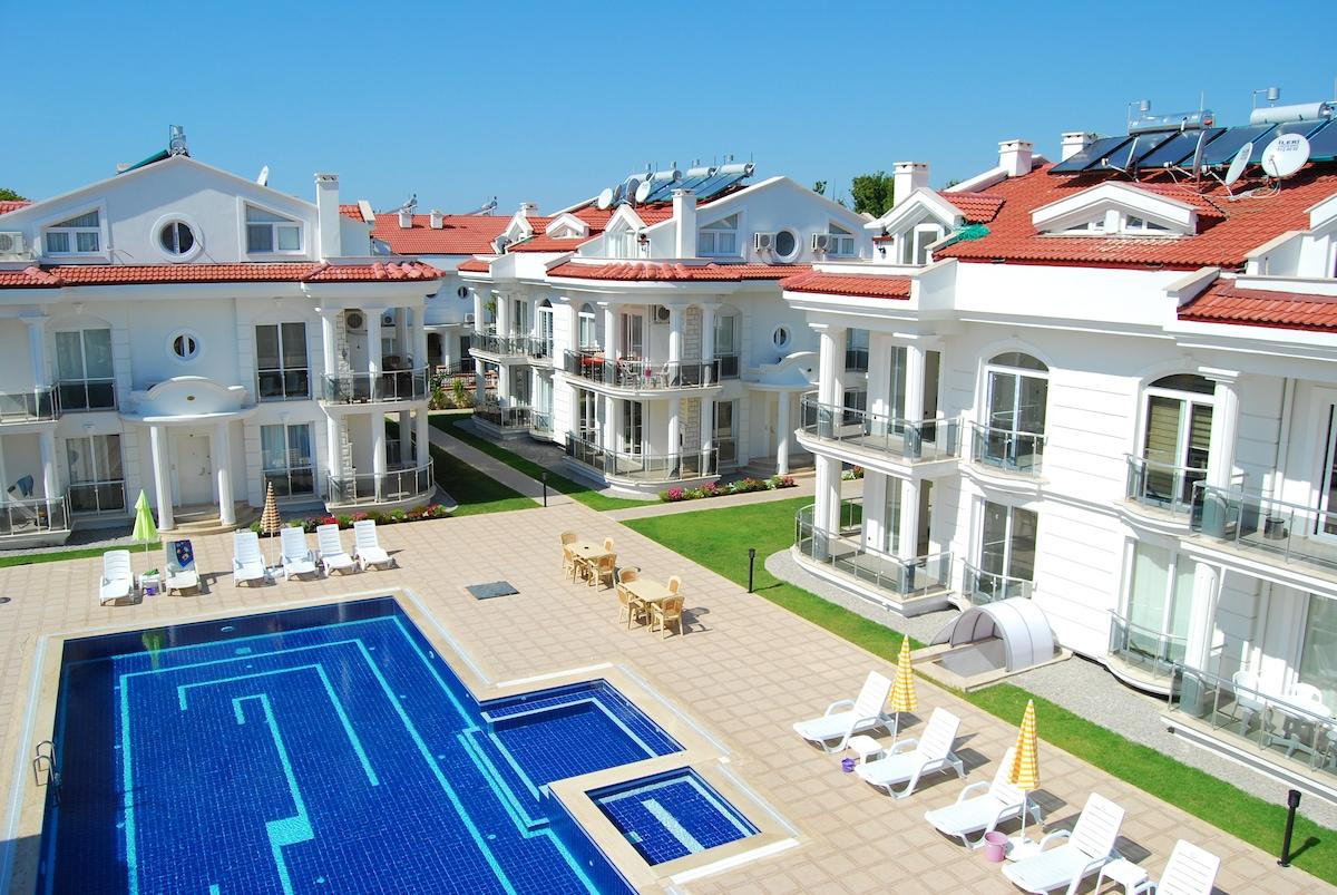 Aerial view of Stella Aparts showing three blocks & garden beds