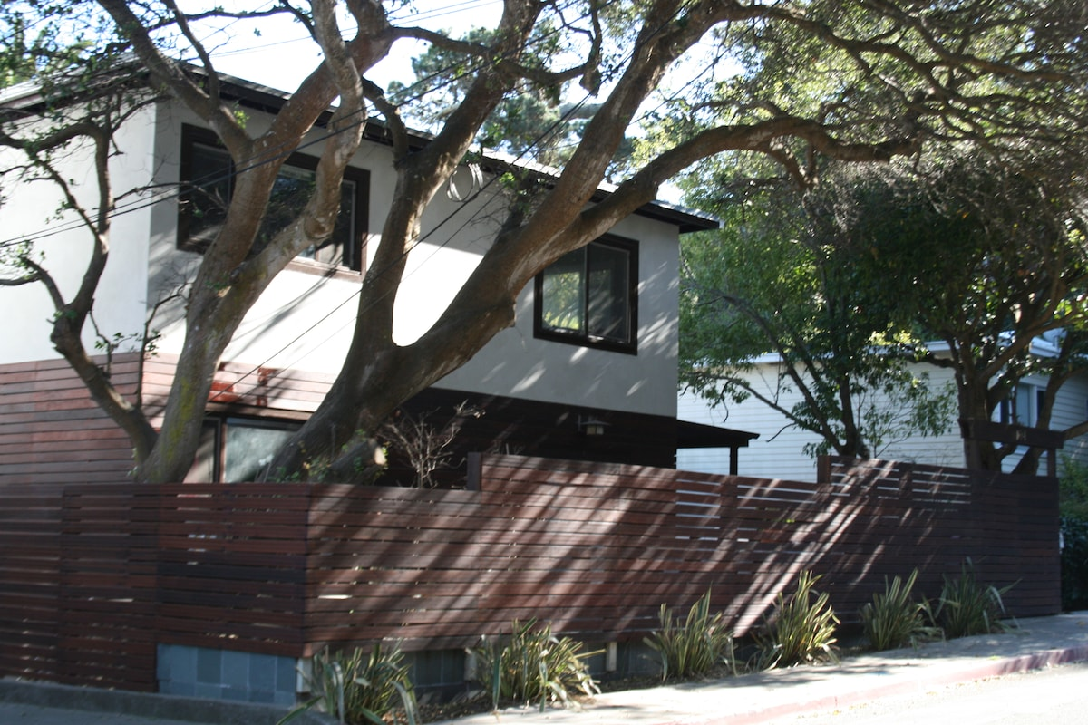 Two large oak tress on property provide a tranquil setting