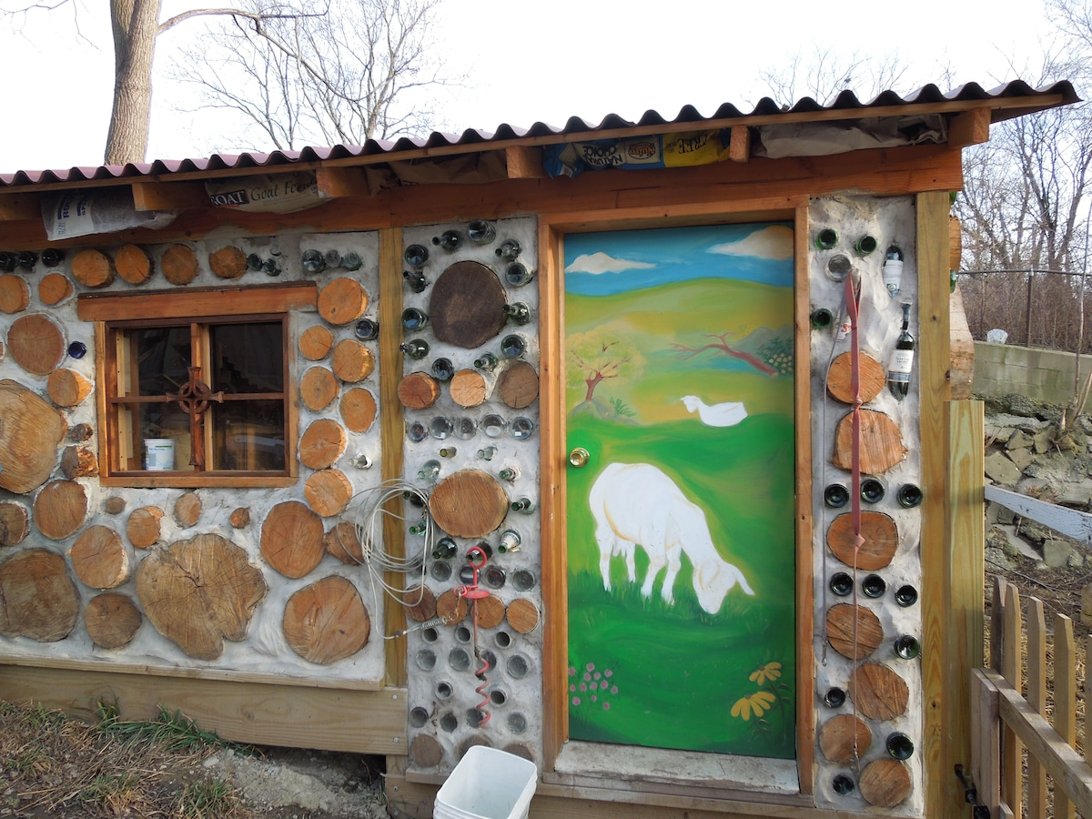 cordwood construction goat milking parlor and shed occupied by our 4 goats