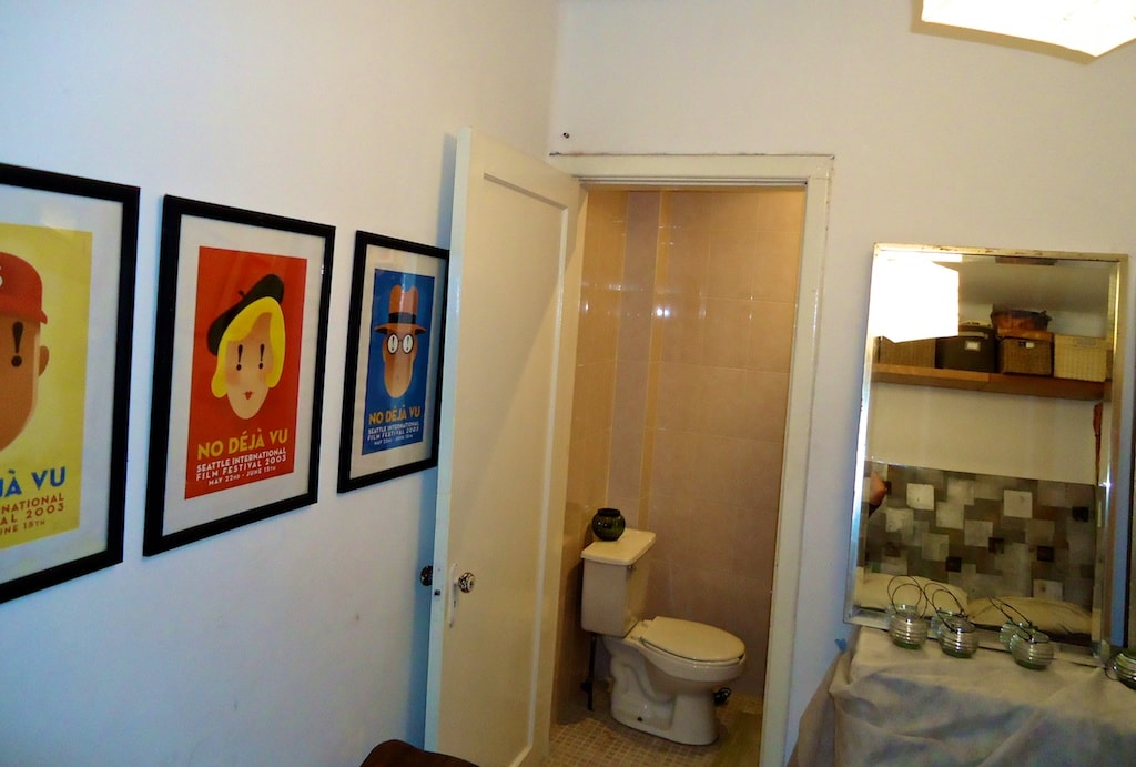 The guest bedroom is small, but it has its own half bath.