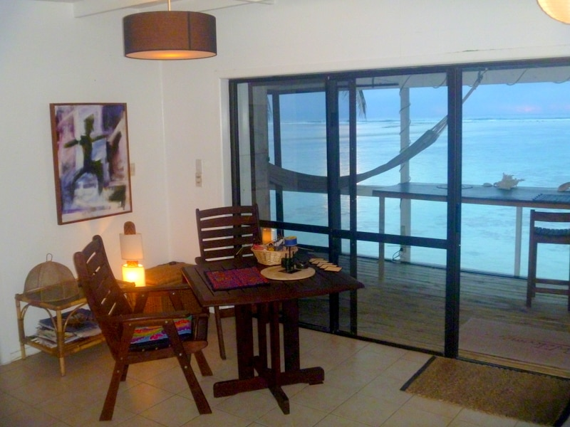 The lounge, looking out to the deck and the good swimming lagoon beyond