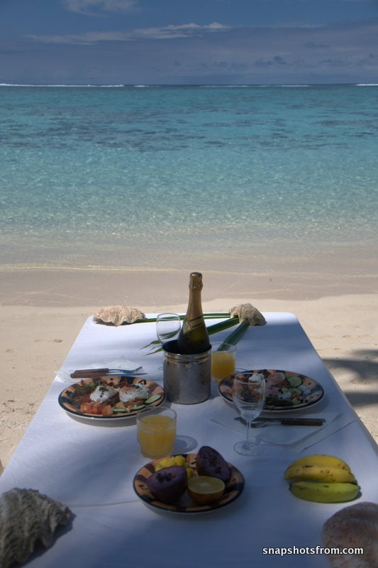 being on the beach means you can drag the table out to the water line to have some outdoor breakfast/dining
