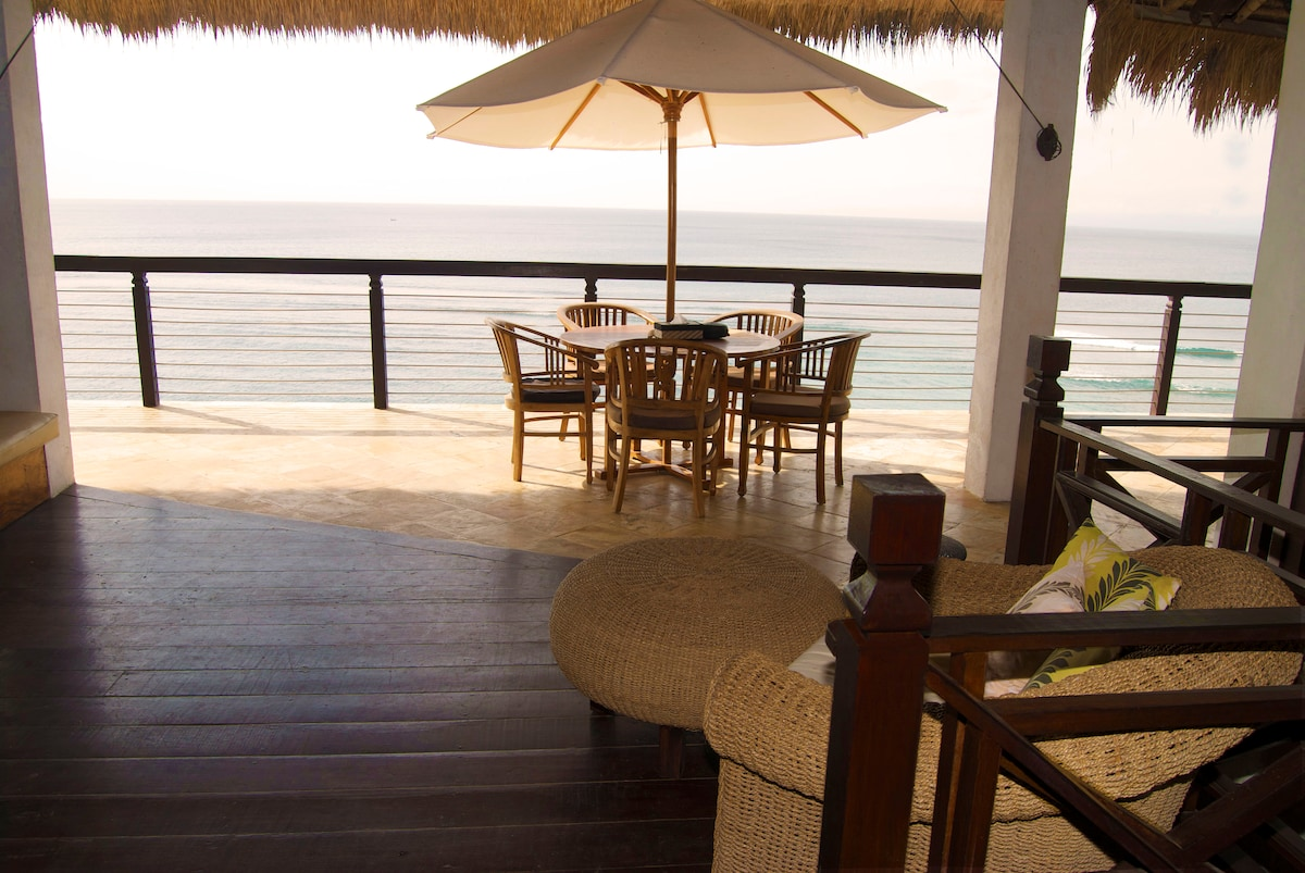 Dining is available off the living room.  The villa offers a cozy umbrella covered dining table and an indoor 10-12 person dining table, both looking out to the ocean.