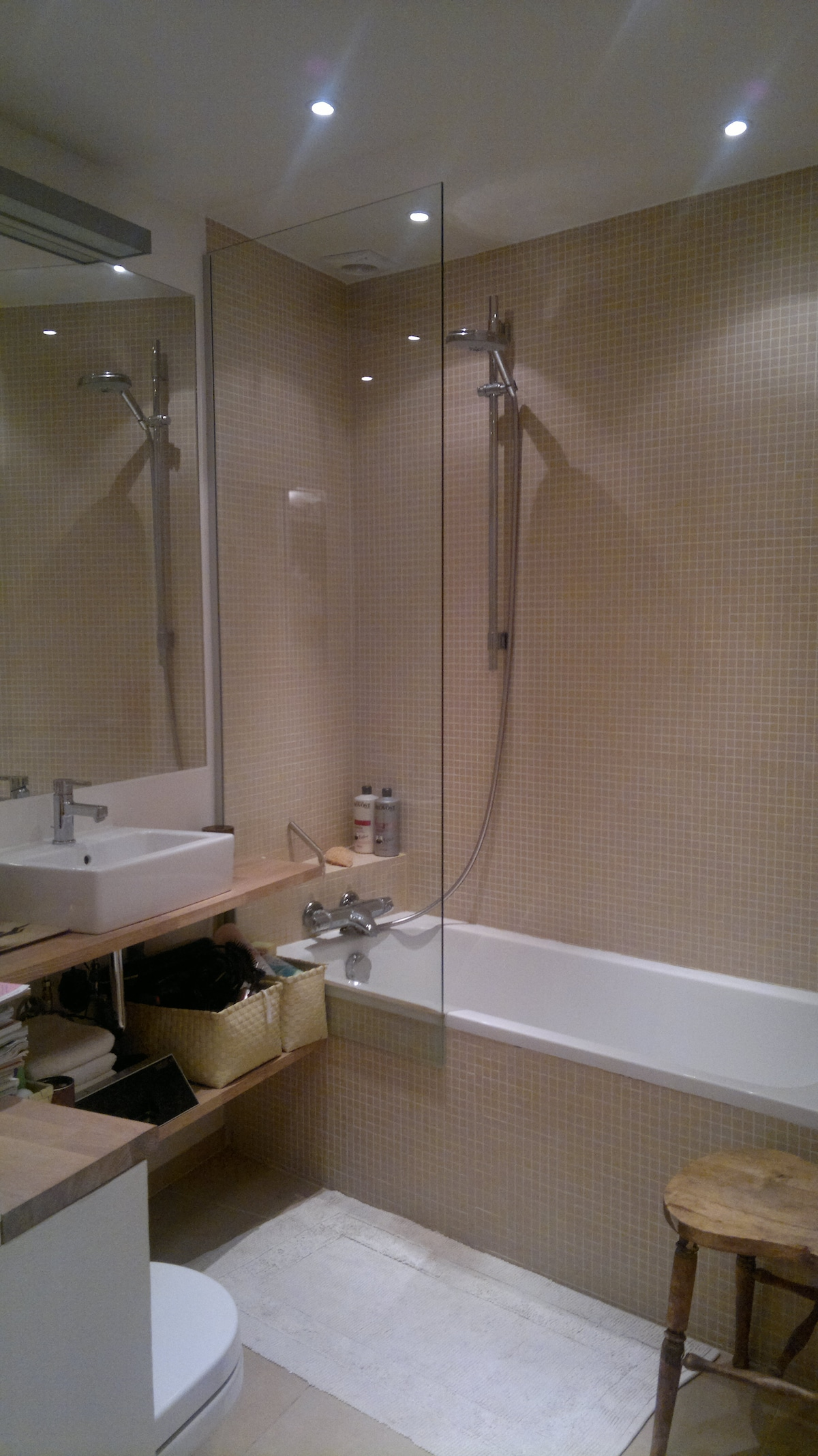 Our beautiful bath room with bath tub, shower, heating in the floor and mirror - all shampoo, conditioner, soft towels etc. provided!