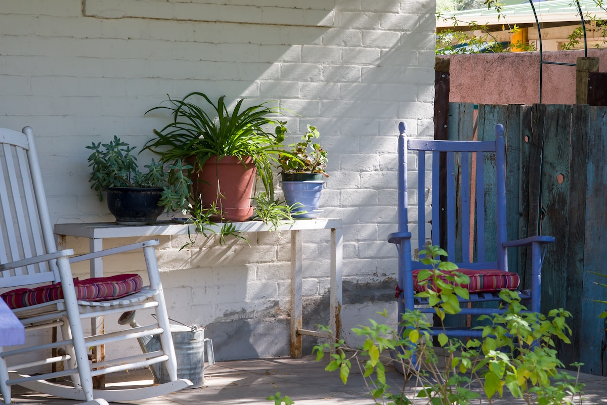 Shady front porch, perfect for relaxing and watching the amazing Tucson sunsets.
