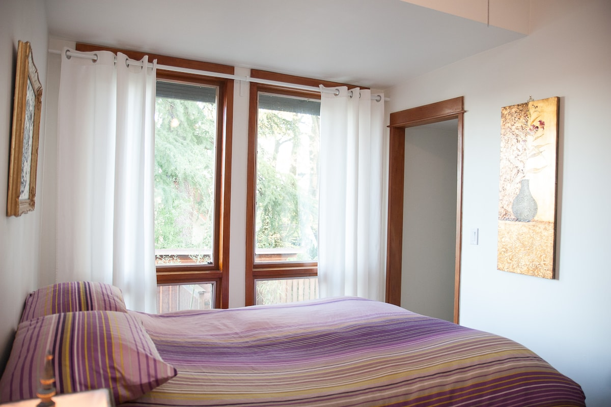 Pretty bedroom with eastern light. Walk-in closet on the right.