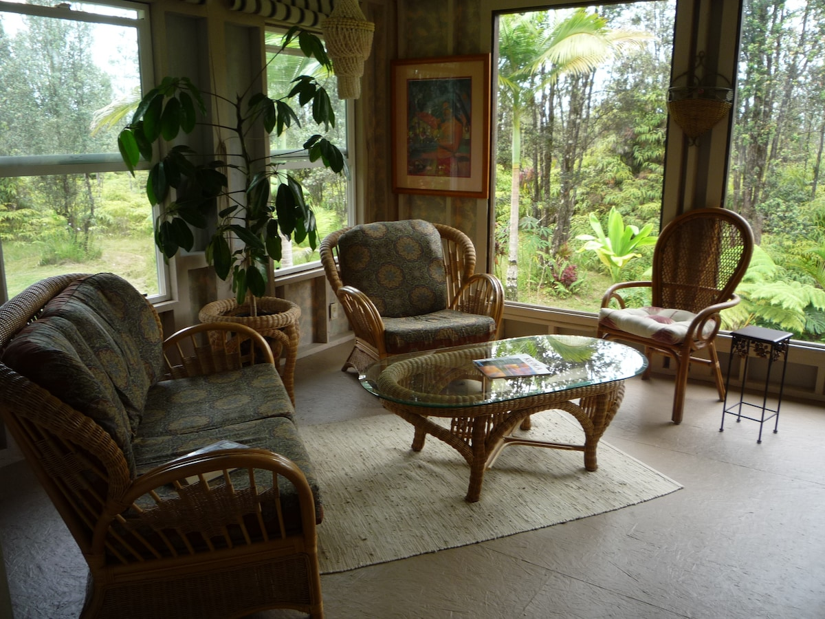 """Living room with views out """"Big"""" windows."""