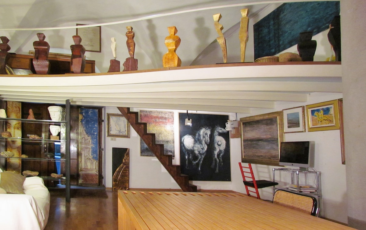 The gallery whit fresco paintings sofa' bed, design table and the big loft with a sigle bed and the sculptures