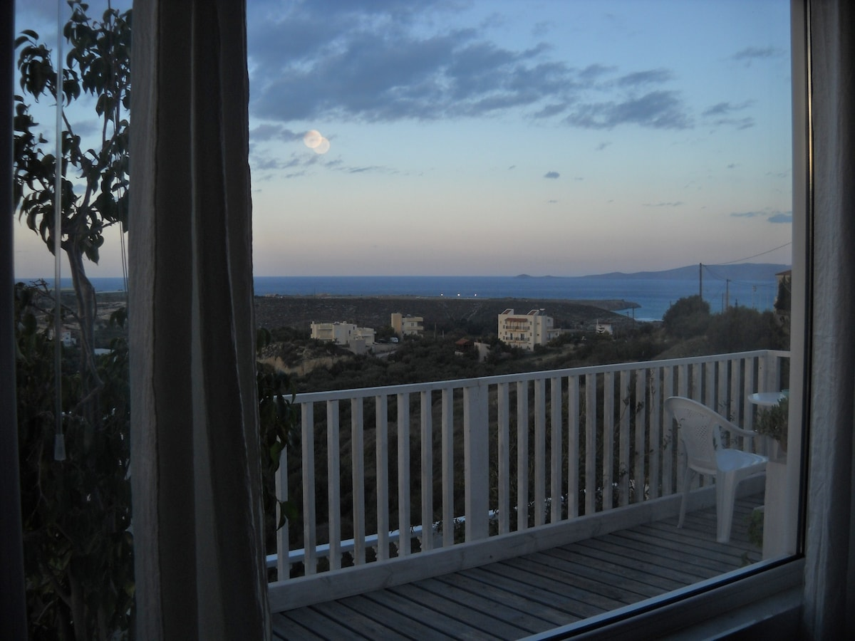Sunset from the livingroom window and deck overlooking the Mediterranean Sea and Dia island