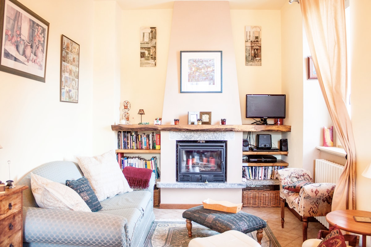 Light and airy living room in summer; cosy with central heating and log fire in winter.