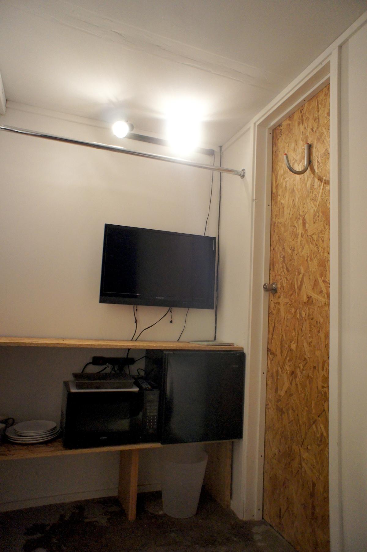 TV with NETFLIX, mini fridge and microwave