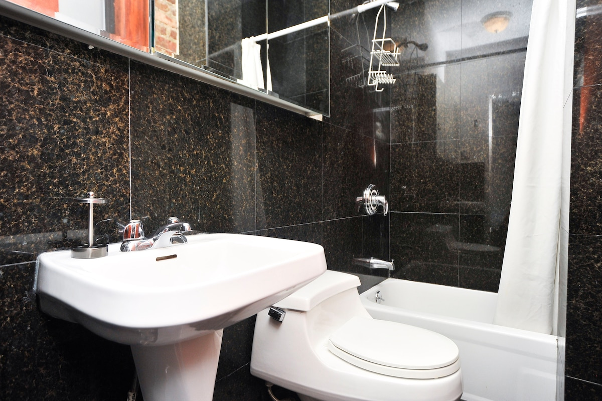 The black marble private bathroom! Used only by the guest room (entrance is insdie this bedroom).