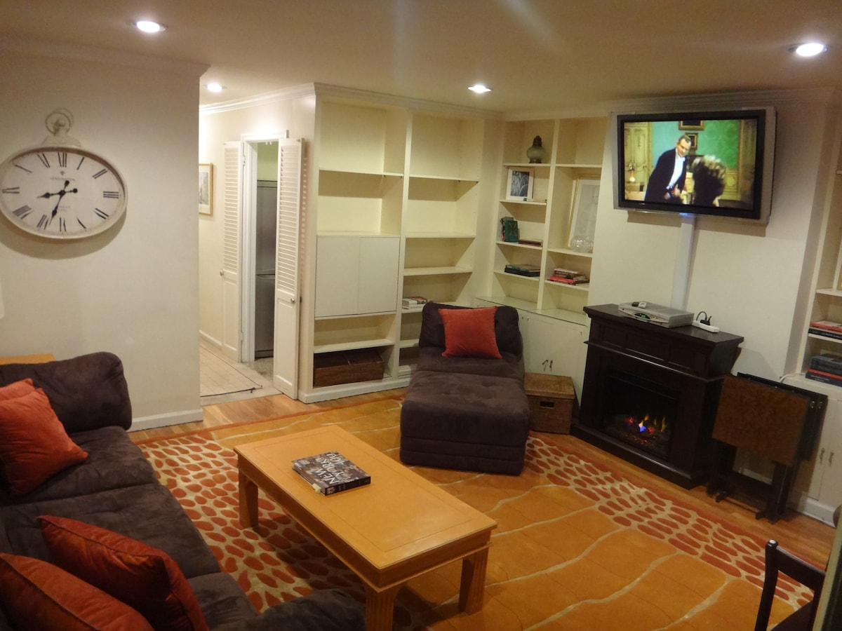 """Living room. electric fire place. Wall mounted 42"""" Sony Plasma TV. with full cable service and all premium movie channels included. notice the entrance to the kitchen"""