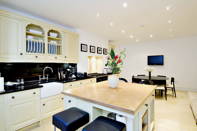Large family kitchen with sofa, seating and dinner settings for 12 persons and more