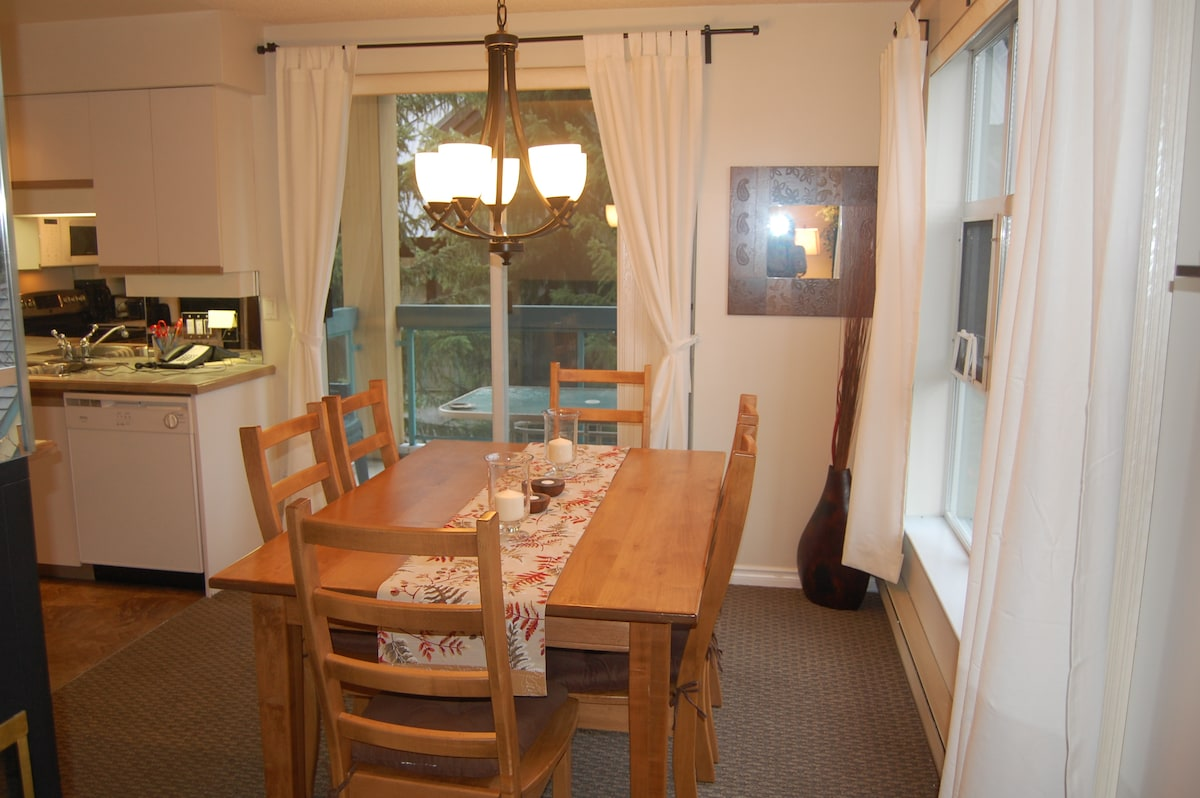 Large dining room with seating for 8.  Balcony with patio table and chairs off the dining room.