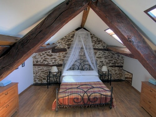 Large romantic bedroom up in the eves
