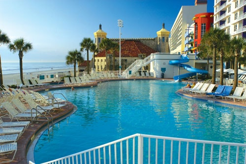 Two outdoor pools, one with water slide and water fall. Indoor pool -kiddie pool with play area