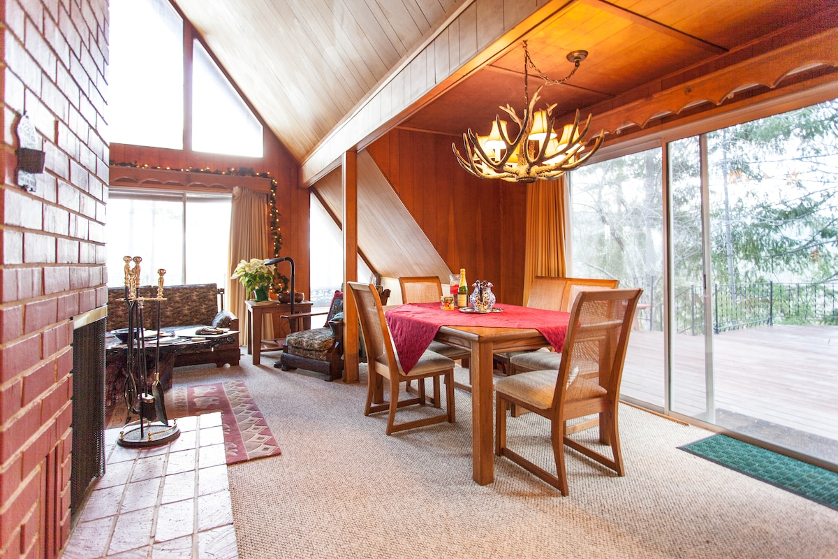 Dining area by living room and large deck