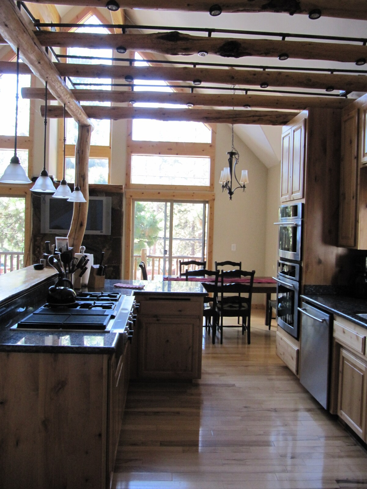 Modern fully stocked kitchen with stainless appliances, granite countertops and double oven