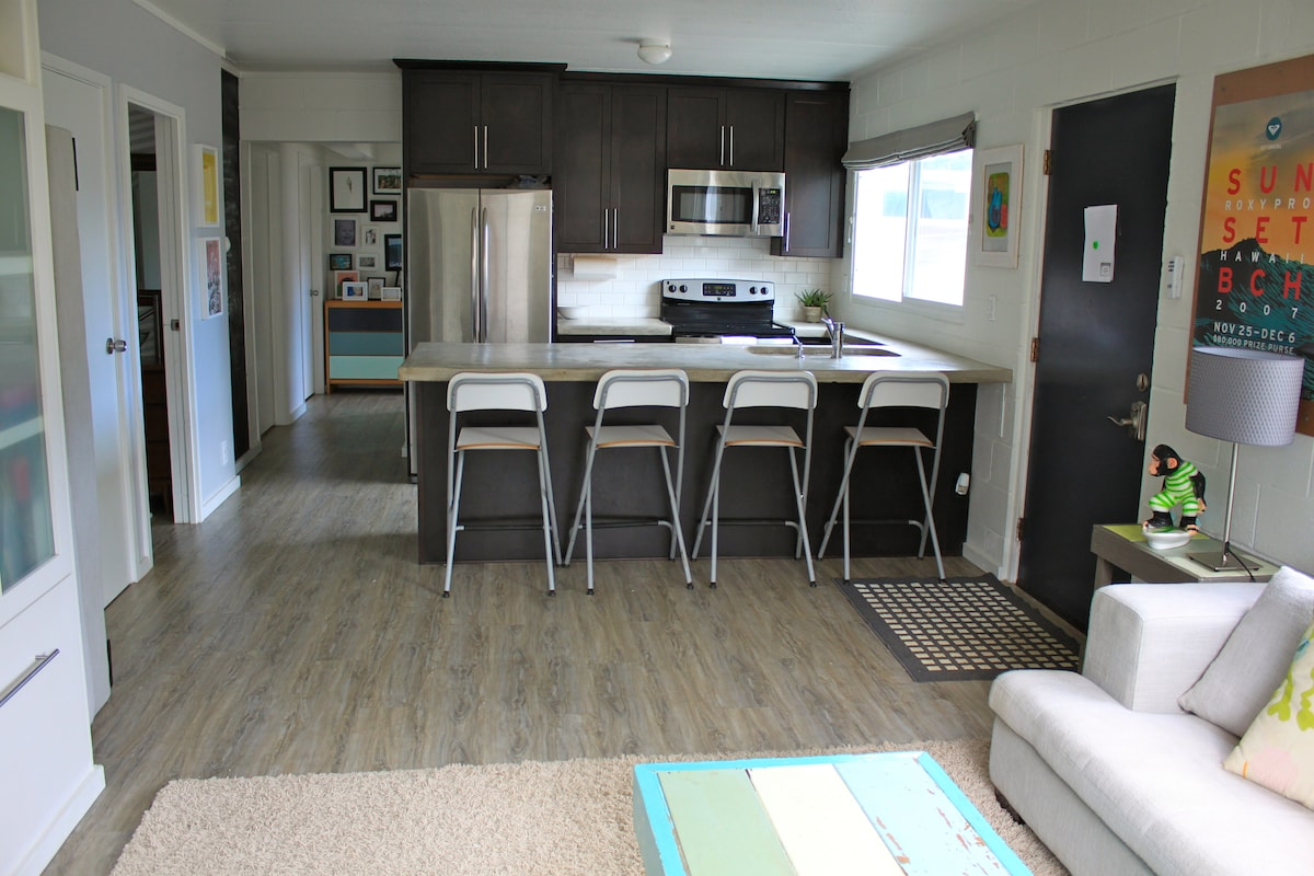View from living room, into kitchen and down hall to two bedrooms and laundry room
