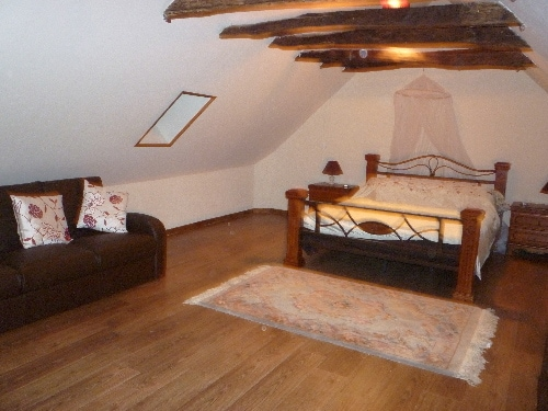 The master bedroom is very large and has a lovely seating area with two sofa beds