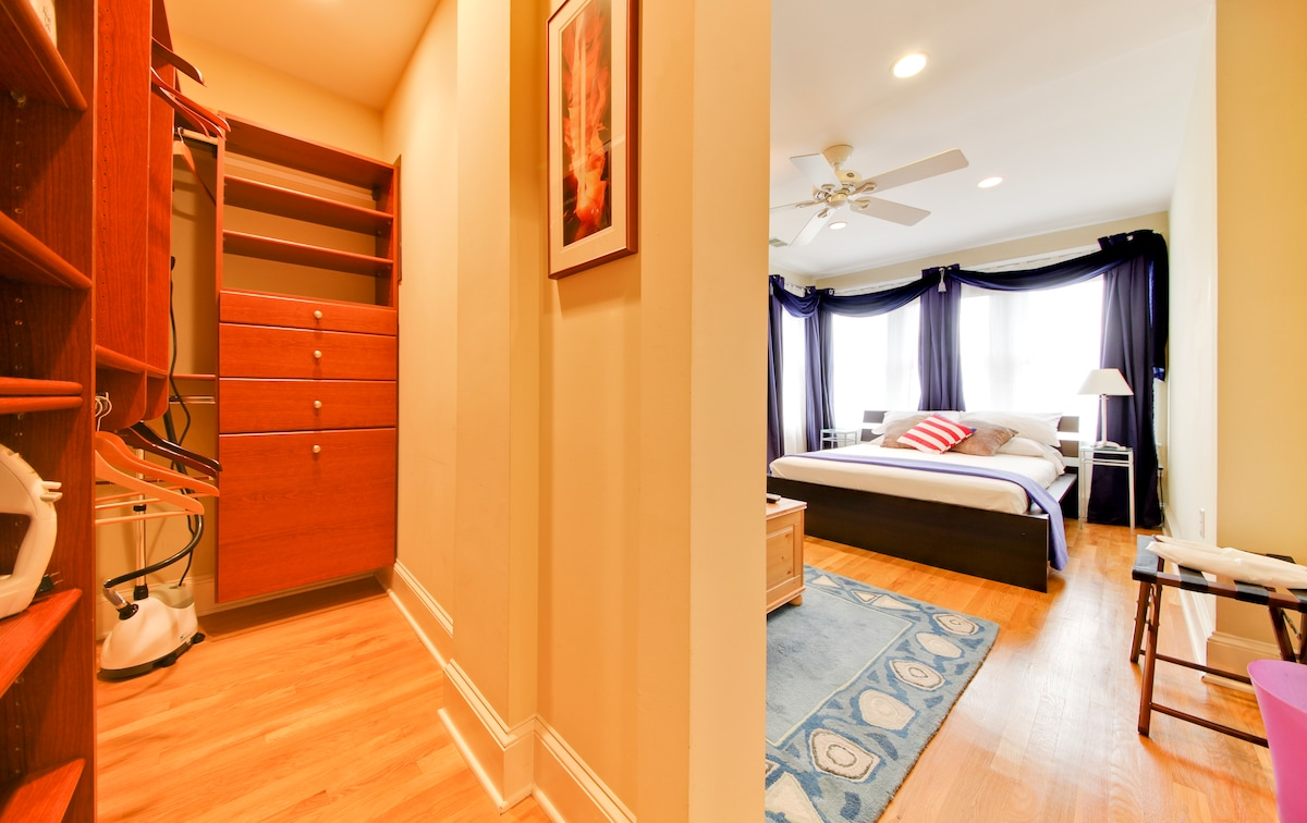 Walk-in closet with tons of space, hangers, and even a clothes steamer!