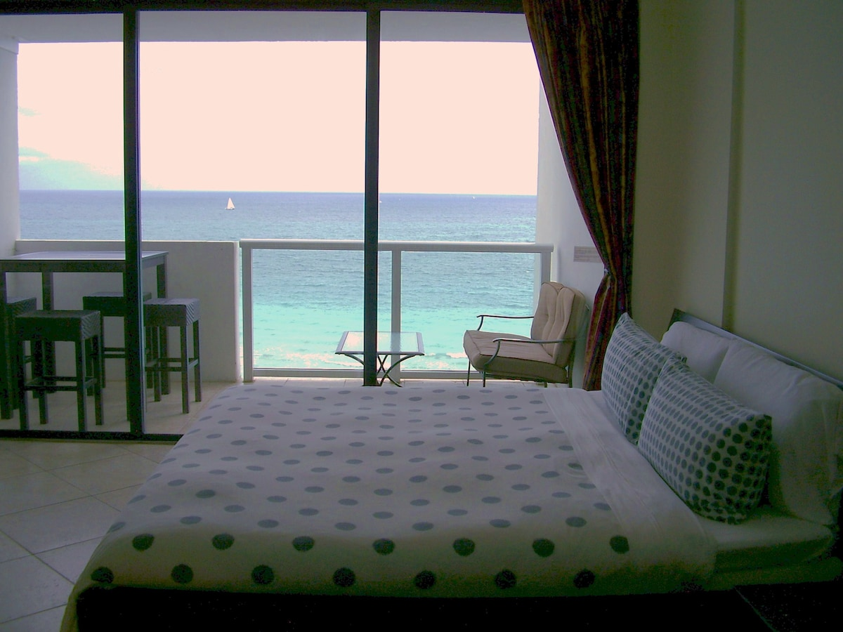 Private Balcony overlooking the ocean.. Wake up to beautiful sunrises and go to bed to a moonlit ocean